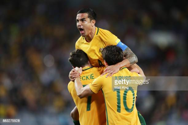 Tim Cahill of Australia celebrates scoring their first goal during the 2018 FIFA World Cup Asian Playoff match between the Australian Socceroos and...