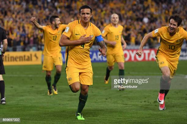 Tim Cahill of Australia celebrates with teammates after scoring against Syria during their 2018 World Cup football qualifying match against Syria...
