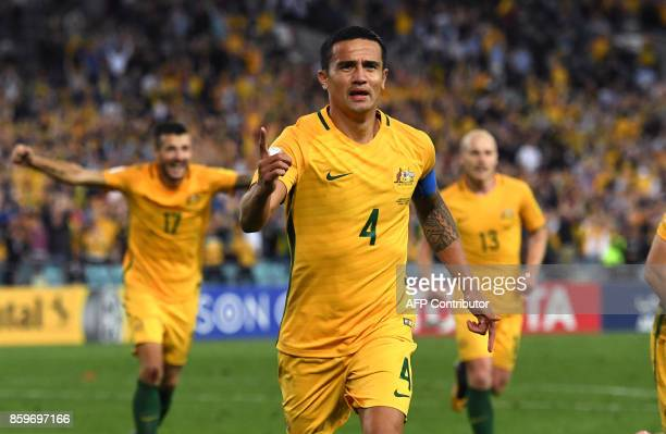 TOPSHOT Tim Cahill of Australia celebrates with teammates after scoring against Syria during their 2018 World Cup football qualifying match against...