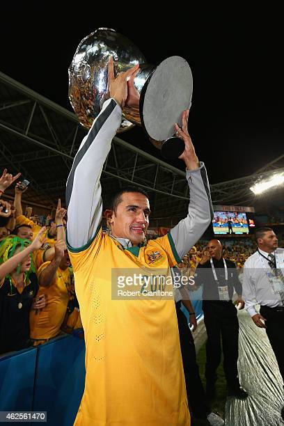 Tim Cahill of Australia celebrates with the winners trophy after Australia defeated Korea republic at the 2015 Asian Cup final match between Korea...