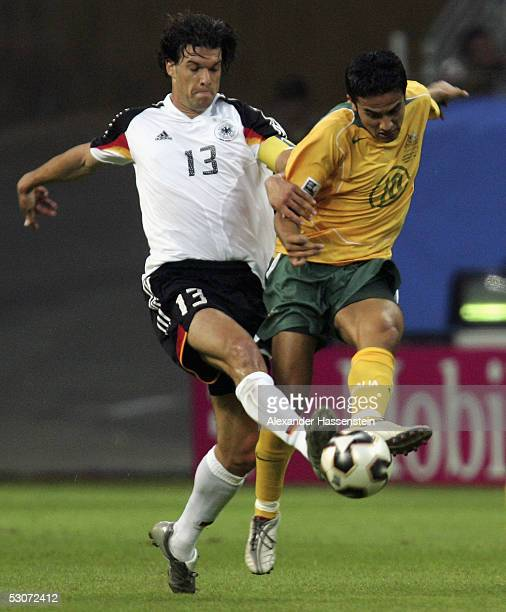 Tim Cahill of Australia challenges for the ball with Michael Ballack of Germany during the FIFA Confederations Cup 2005 match between Germany and...
