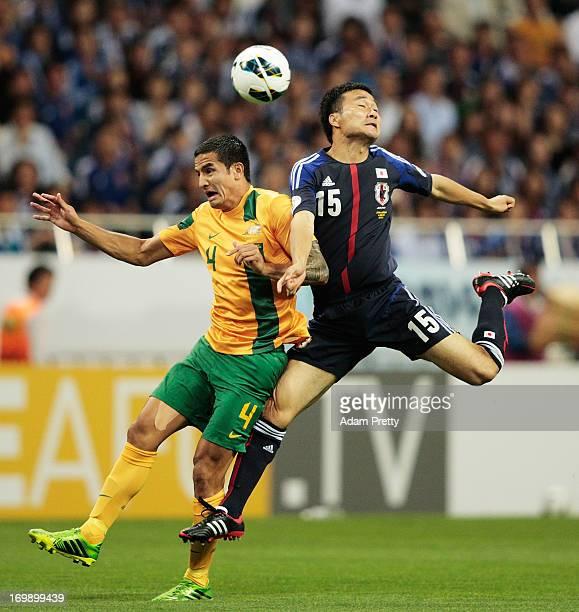 Tim Cahill of Australia challenges Yasuyuki Konno of Japan during the FIFA World Cup qualifier match between Japan and Australia at Saitama Stadium...
