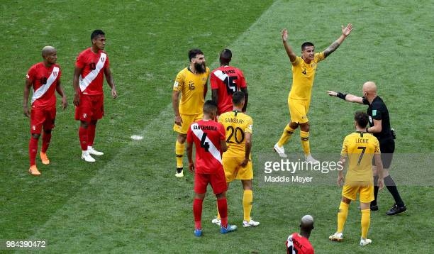 Tim Cahill of Australia confronts referee Sergei Karasev during the 2018 FIFA World Cup Russia group C match between Australia and Peru at Fisht...