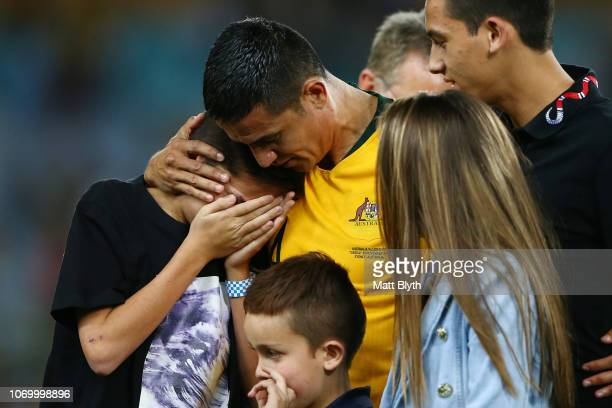 Tim Cahill of Australia embraces his children during a presentation for him following the International Friendly Match between the Australian...