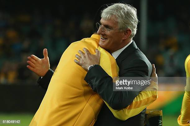 Tim Cahill of Australia embraces Steven Lowy the chairman of Football Federation Australia before kickoff in the 2018 FIFA World Cup Qualification...