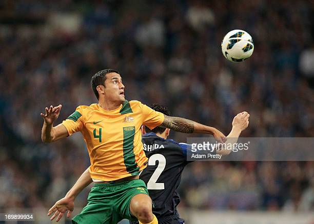 Tim Cahill of Australia flies high during the FIFA World Cup qualifier match between Japan and Australia at Saitama Stadium on June 4, 2013 in...