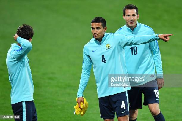 Tim Cahill of Australia gestures to Robbie Kruse of Australia during the Australian Socceroos training session at the Adelaide Oval on June 7 2017 in...