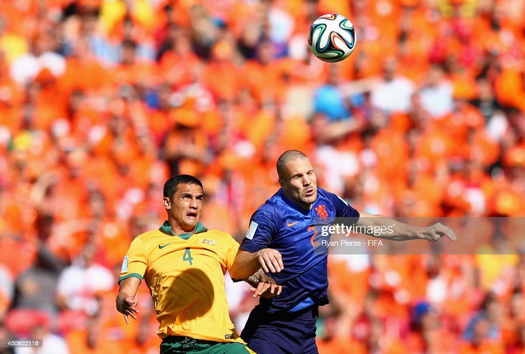 Tim Cahill of Australia goes up for the ball with Ron Vlaar of the Netherlands during the 2014 FIFA World Cup Brazil Group B match between Australia and Netherlands at Estadio Beira-Rio on June 18, 2014 in Porto Alegre, Brazil.