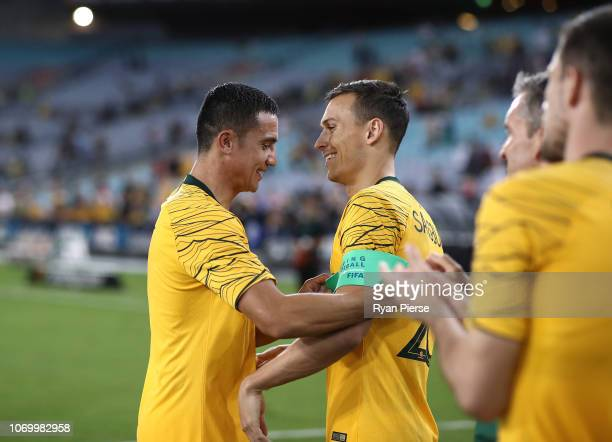 Tim Cahill of Australia hands the captains armband back to Trent Sainsbury of Australia after the International Friendly Match between the Australian...