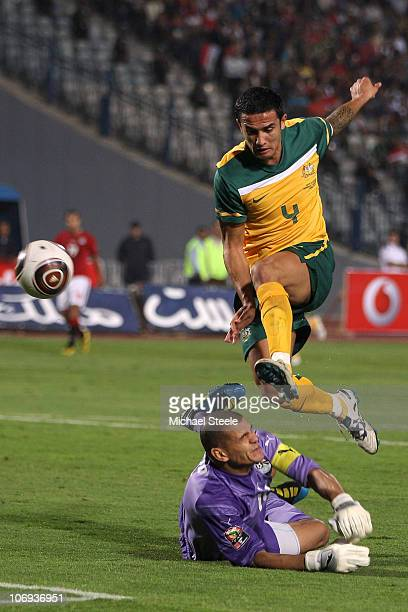 Tim Cahill of Australia has a shot blocked by AbdulWahed El Sayed during the Egypt v Australia International Friendly match at the Cairo...