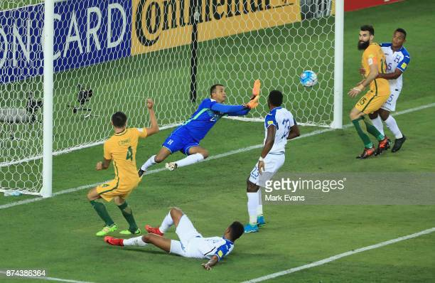 Tim Cahill of Australia has a shot on goal saved by goalkeeper Donis Escober of Honduras during the 2018 FIFA World Cup Qualifiers Leg 2 match...