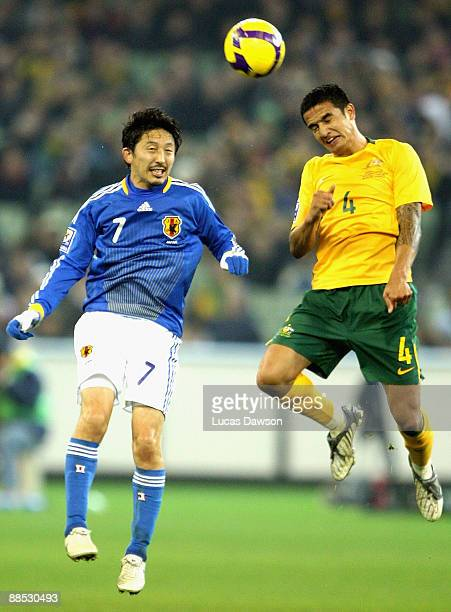 Tim Cahill of Australia heads the ball against Hideo Hashimoto of Japan during the 2010 FIFA World Cup Asian qualifying match between the Australian...