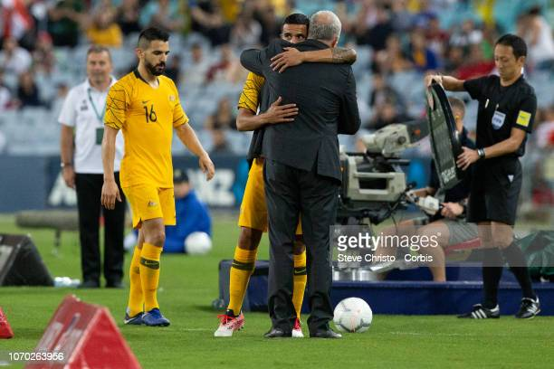 Tim Cahill of Australia hugs coach Graham Arnold before he takes the field during the International Friendly Match between the Australian Socceroos...
