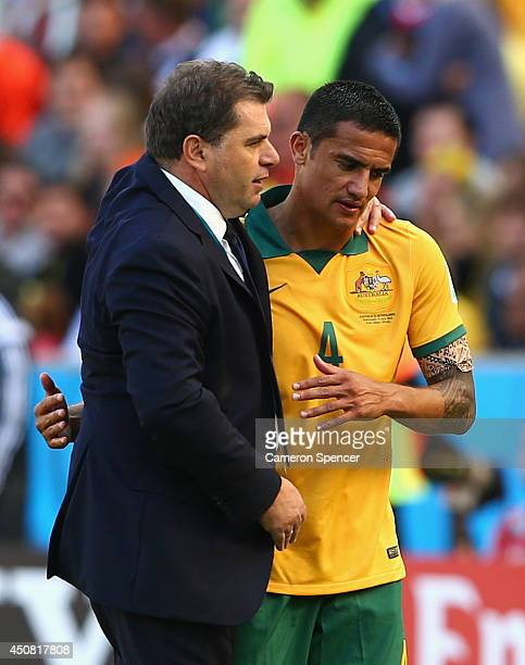Tim Cahill of Australia hugs head coach Ange Postecoglou after exiting the game during the 2014 FIFA World Cup Brazil Group B match between Australia...