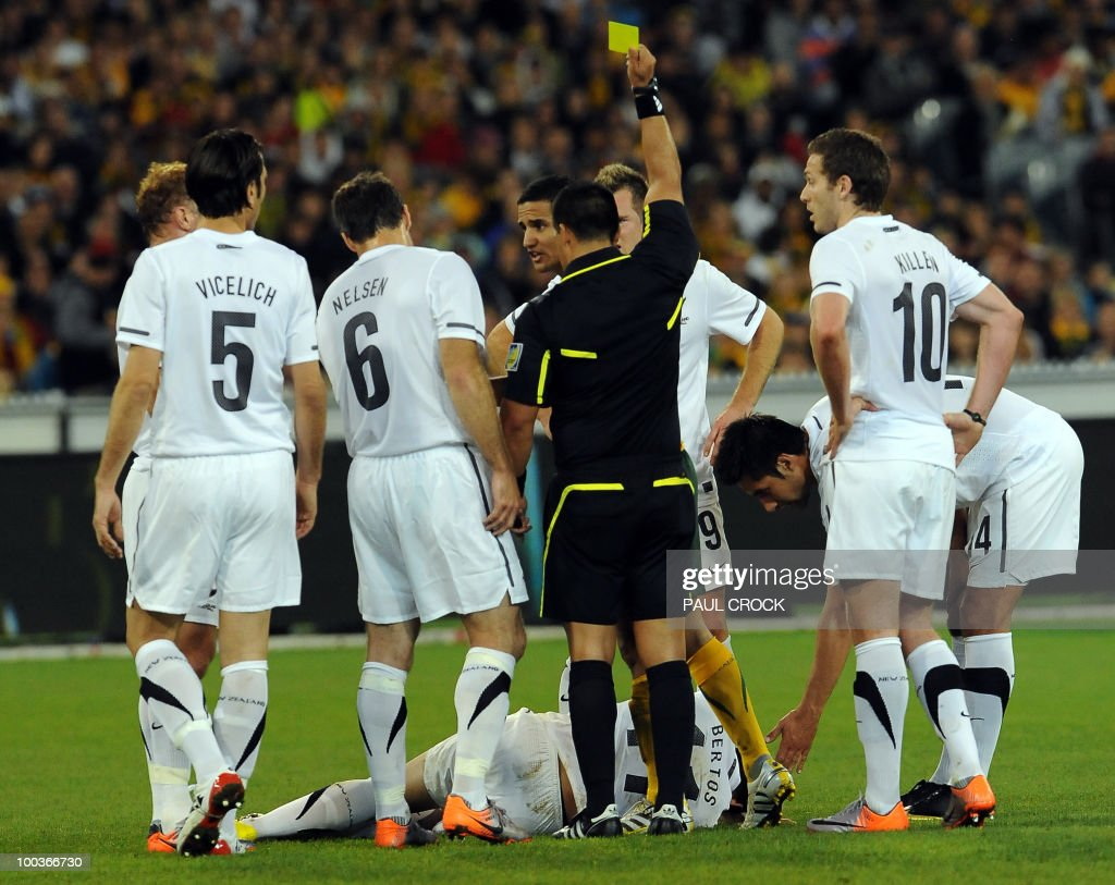 Tim Cahill of Australia is given a yellow card after a clash with Leo Bertos of New Zealand during their friendly international football match in Melboune on May 24, 2010. New Zealand's All Whites lead the Australian Soceroos 1-0 at half-time. RESTRICTED