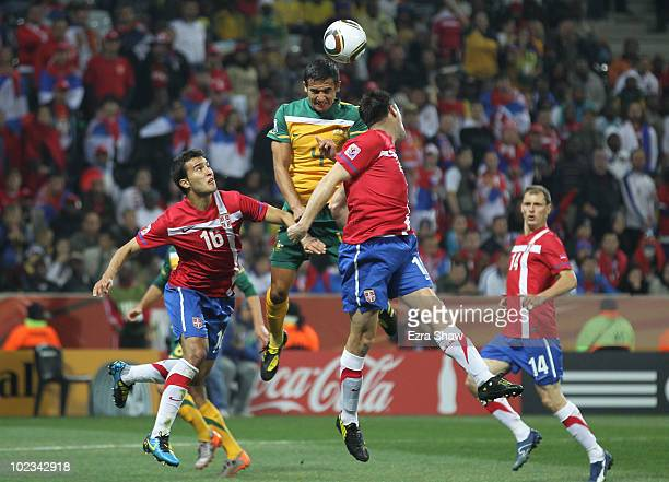 Tim Cahill of Australia jumps for the ball under pressure from Ivan Obradovic of Serbia during the 2010 FIFA World Cup South Africa Group D match...
