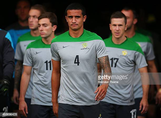Tim Cahill of Australia leads his fellow players onto the field during an Australian Socceroos training session at ANZ Stadium on May 25 2014 in...