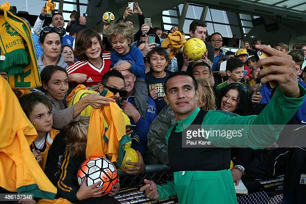Tim Cahill of Australia poses for photos with fans during the Australian Socceroos fan day at nib Stadium on September 1 2015 in Perth Australia