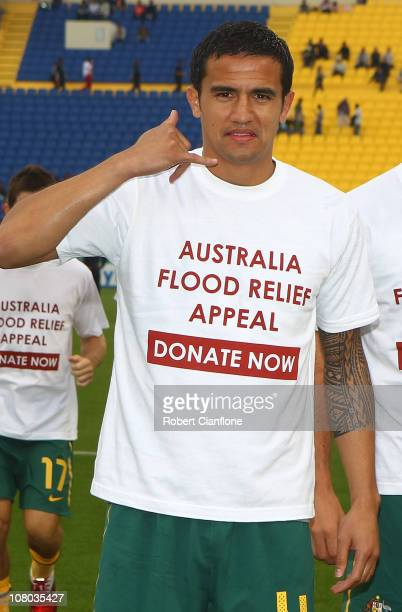 Tim Cahill of Australia poses with a t-shirt which shows his support for flood victims in Queensland, Australia, prior to the AFC Asian Cup Group C...