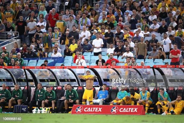 Tim Cahill of Australia pulls on his Australian shirt for the last time during the International Friendly Match between the Australian Socceroos and...