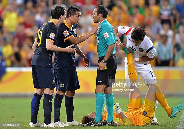 Tim Cahill of Australia questions referee Nawaf Shukralla after receiving a yellow card during the 2015 Asian Cup match between Australia and Korea...