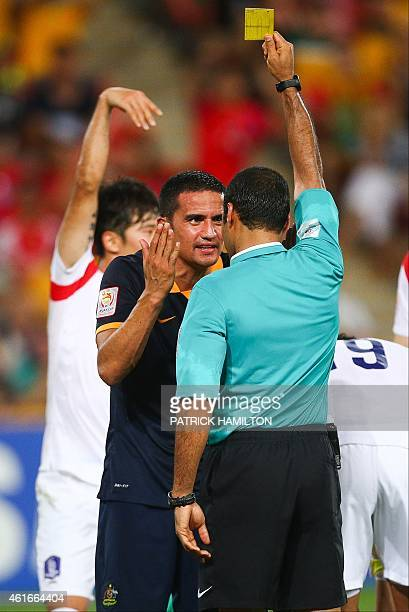 Tim Cahill of Australia questions referee Nawaf Shukralla during the first round Asian Cup football match between South Korea and Australia at the...