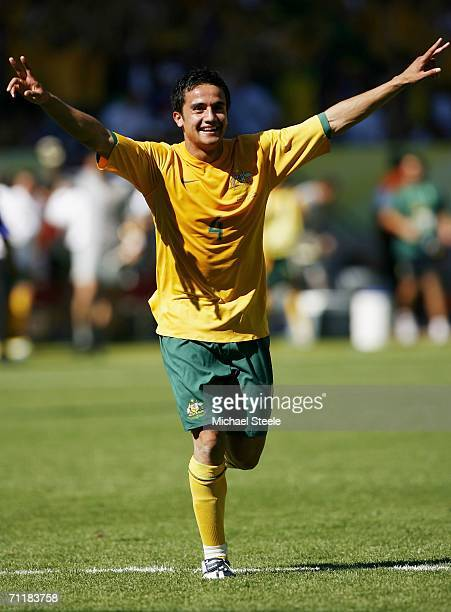 Tim Cahill of Australia raises his arms to celebrate after scoring his team's second goal during the FIFA World Cup Germany 2006 Group F match...
