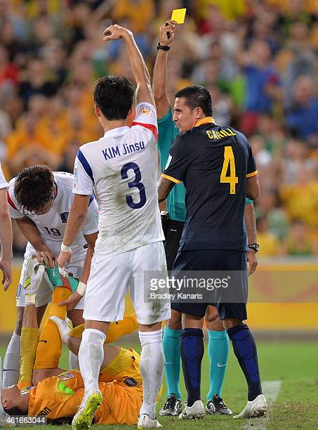 Tim Cahill of Australia receives a yellow card from referee Nawaf Shukralla during the 2015 Asian Cup match between Australia and Korea Republic at...