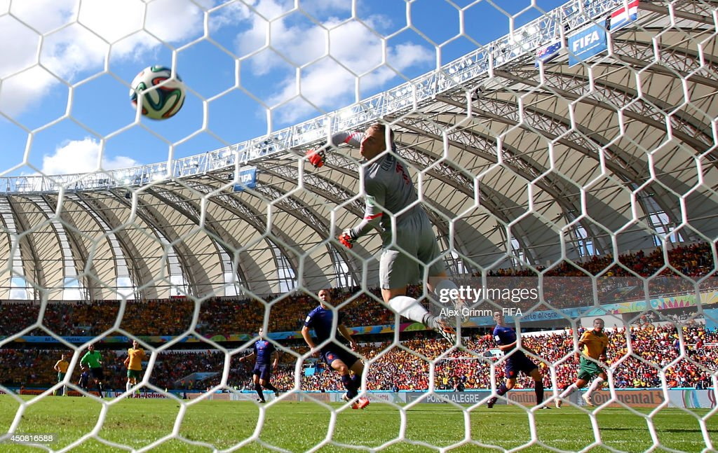 Tim Cahill of Australia (R) scores the team's first goal past Jasper Cillessen of the Netherlands during the 2014 FIFA World Cup Brazil Group B match between Australia and Netherlands at Estadio Beira-Rio on June 18, 2014 in Porto Alegre, Brazil.