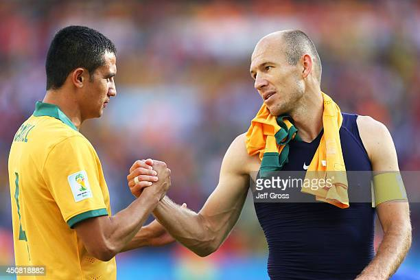 Tim Cahill of Australia shakes hands with Arjen Robben of the Netherlands after the Netherlands defeated Australia 3-2 during the 2014 FIFA World Cup...