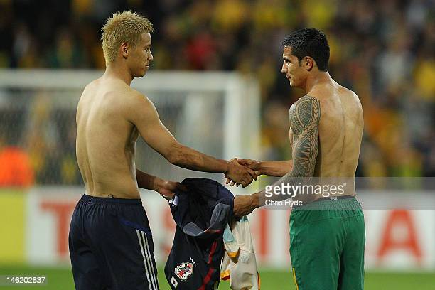 Tim Cahill of Australia shakes hands with Keisuke Honda of Japan after Australia drew with Japan during the FIFA World Cup Asian Qualifier match...