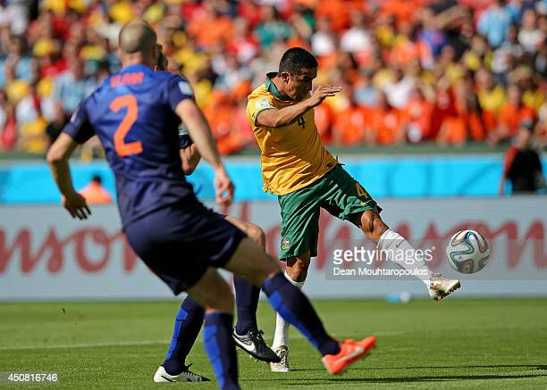 Tim Cahill of Australia shoots and scores his team's first goal during the 2014 FIFA World Cup Brazil Group B match between Australia and Netherlands...