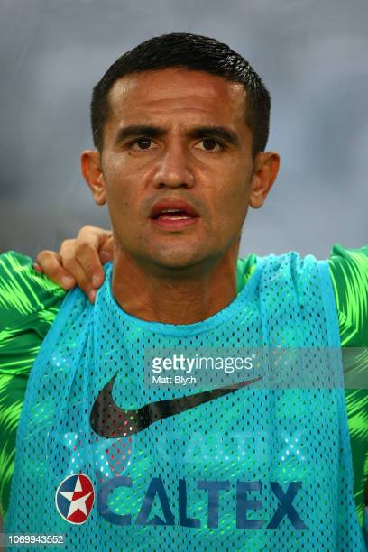 Tim Cahill of Australia sings the National Anthem ahead of his last international game during the International Friendly Match between the Australian...