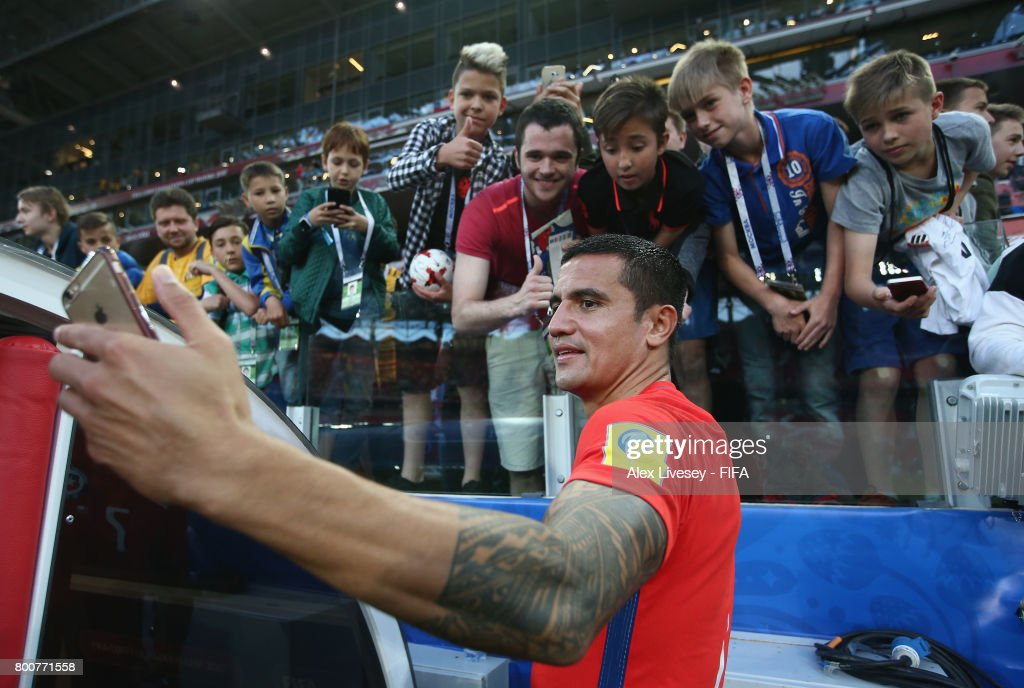 Tim Cahill of Australia takes a selfie photograph with fans after the FIFA Confederations Cup Russia 2017 Group B match between Chile and Australia at Spartak Stadium on June 25, 2017 in Moscow, Russia.