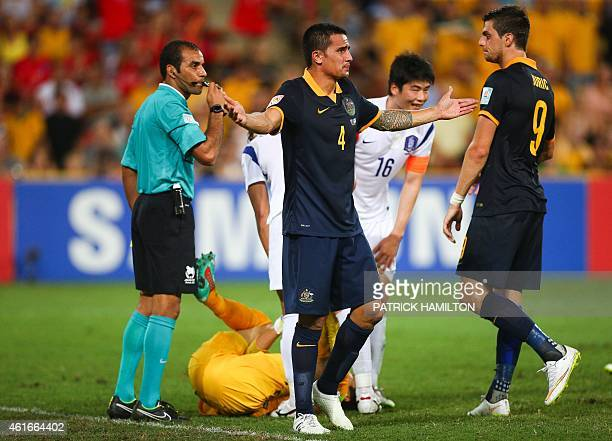 Tim Cahill of Australia throws his arms in the air as he questions referee Nawaf Shukralla during the first round Asian Cup football match between...