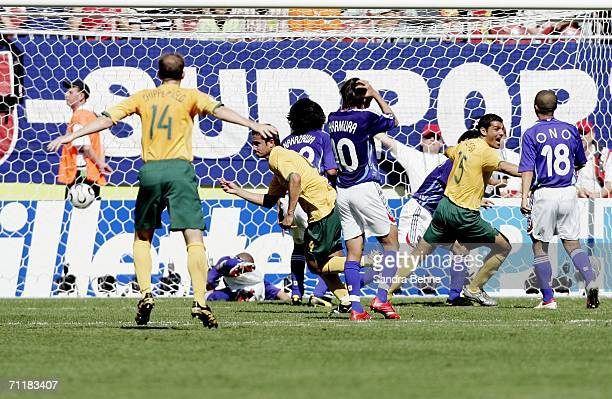 Tim Cahill of Australia turns away and celebrates after scoring his team's first goal during the FIFA World Cup Germany 2006 Group F match between...