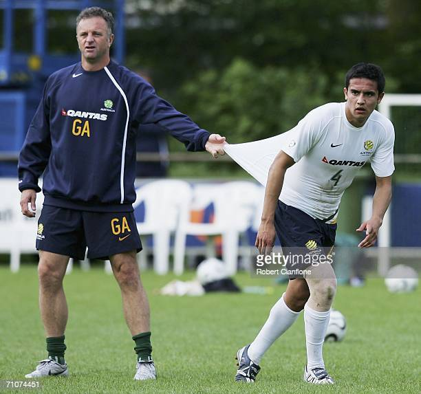 Tim Cahill of Australia with assistant coach Graham Arnold during a training session as Australia prepare for the 2006 World Cup held at the Mierlo...