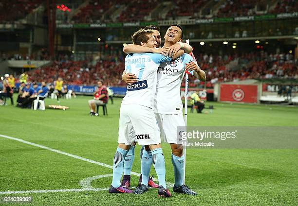 Tim Cahill of City celebrates scoring a goal with team mates during the round seven ALeague match between the Western Sydney Wanderers and Melbourne...