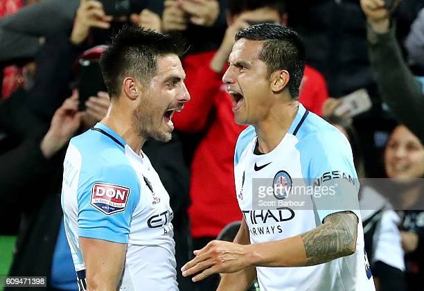 Tim Cahill of City is congratulated by Bruno Fornaroli after scoring his first goal during the FFA Cup Quarter Final between Melbourne and Western...