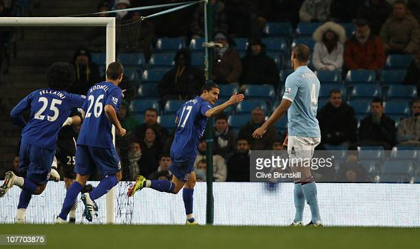 Tim Cahill of Everton celebrates after scoring the first goal during the Barclays Premier League match between Manchester City and Everton at City of...