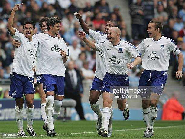 Tim Cahill of Everton celebrates his goal with team mates during the Barclays Premiership match between Manchester City and Everton at the City of...