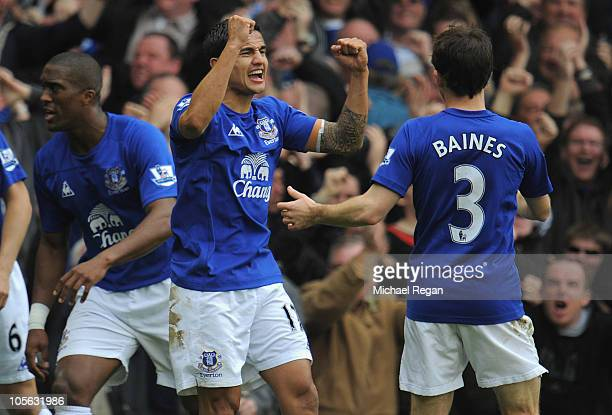 Tim Cahill of Everton celebrates scoring the first goal during the Barclays Premier League match between Everton and Liverpool at Goodison Park on...