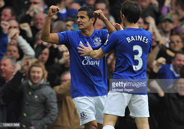 Tim Cahill of Everton celebrates scoring the first goal with Leighton Baines during the Barclays Premier League match between Everton and Liverpool...