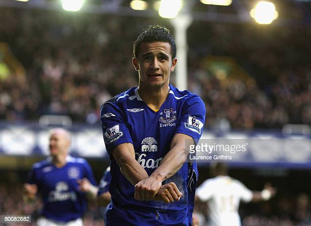 941d061aa52 Tim Cahill of Everton celebrates scoring the second goal during the  Barclays Premier League match between. Everton v Portsmouth ...