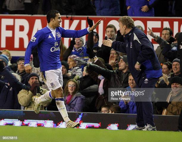 Tim Cahill of Everton celebrates with manager David Moyes during the third round match of The FA Cup sponsored by EON between Everton and Carlisle...
