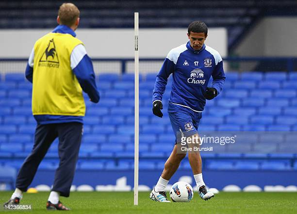 Tim Cahill of Everton in action with team mate Tony Hibbert during an Everton training session at Goodison Park on April 3, 2012 in Liverpool,...