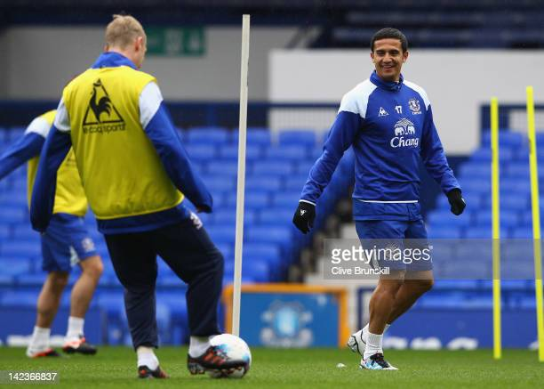Tim Cahill of Everton in good spirits as he shares a joke with team mate Tony Hibbert during an Everton training session at Goodison Park on April 3,...
