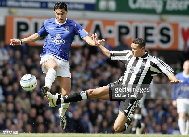 Tim Cahill of Everton is challenged by Jermaine Jenas of Newcastle during the Barclays Premiership match between Everton and Newcastle United at...