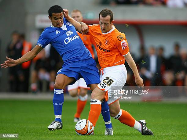 Tim Cahill of Everton is tackled by Charlie Adam of Blackpool during a pre season match between Blackpool and Everton at Bloomfield Road on August 4,...