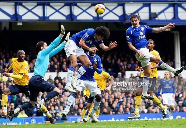 Tim Cahill of Everton rises high to head home his goal during the Barclays Premier League match between Everton and West Bromwich Albion at Goodison...